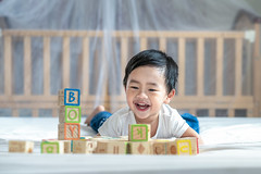 Asian boy play a wooden block on the bed (I love landscape) Tags: baby playing toy blocks child wood nursery toys play colorful room boy block toddler leisure childhood old kid kids development educational fun creativity education asia asian thai wooden mother equipment construction kindergarten sitting infant little building day months beautiful care game caucasian discovery hand cute year background portrait white playroom
