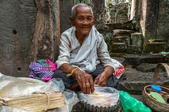 Lucky Charms (shapeshift) Tags: ancient angkor asia cambodia candid candidphotography davidpham davidphamsf documentary nun people portrait preahkhan ruins shapeshift siemreap siemreapprovince southeastasia streetphotography temple travel woman krongsiemreap kh