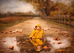 Puddles ({jessica drossin}) Tags: jessicadrossin portrait child yellow reflection park trees rain fall leaf leaves puddles wwwjessicadrossincom childhood puddle joy