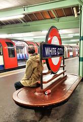 White City (R~P~M) Tags: train railway station sign seat bench artdeco enamel vitreousenamel passenger sitting whitecity centralline londonunderground london england uk unitedkingdom greatbritain people sit seated