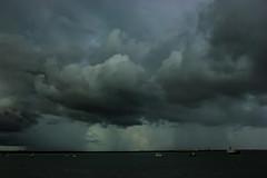 Storm With Heavy Rain (Markus Branse) Tags: meer wasser himmel bucht berg landschaft ozean boot bedeckt wolke