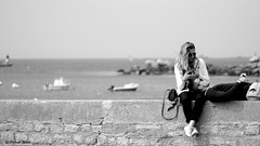 Alone in the world (patrick_milan) Tags: portsall mer sea quay portrait finistere bretagne woman girl