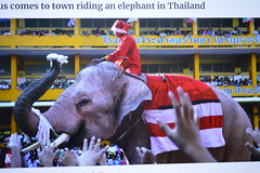 santa elephant giving out dolls at a school (the foreign photographer - ฝรั่งถ่) Tags: santa elephant dolls school ayuttahaya province thailand nikon christmas