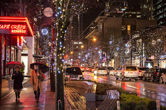 City Sidewalks 🚶♀️☔ Vancouver, BC (Michael Thornquist) Tags: raincouver rain umbrella robsonstreet onrobson street fashion vancityvogue cafecrepe christmas christmaslights led wetstreet reflection vancouver 604now photos604 explorebc explorecanada canoncanada ilovebc britishcolumbia pacificnorthwest pnw canada 500px
