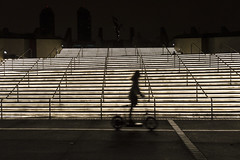 Blurred Motion Electric Scooter Rider in Front of San Diego Convention Center (aaronrhawkins) Tags: electric scooter rental downtown sandiego conventioncenter staircase stairs backlit lights lit rent blurred motion shadow silhouette night dark sidewalk speed aaronhawkins