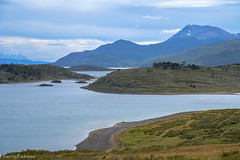 The expanse of Tierra del Fuego / Огнеземельские дали (Vladimir Zhdanov) Tags: travel argentina tierradelfuego ocean water wave mountains mountainside nature field grass tree sky cloud beach snow hill