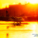 A Harbour Air Twin Otter Under the Victoria Harbour Sunrise in HDR thumbnail