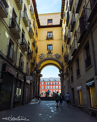 madrid012 (by claudine) Tags: capturedbylight l16 light16 architecture spain madrid los heroes del 7 de julio 1822 arch archway entrance square yellow orange tourism tourist people street sign storefront windows balconies plazamayor