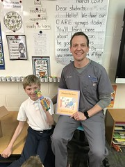 Mystery Reader: This week's mystery reader was a dentist.  He read Dr. DeSoto.  A fun fiction story about a mouse dentist that needed to help a fox.  The class was excited to receive a free light up toothbrush at the end. (st.brigid2) Tags: