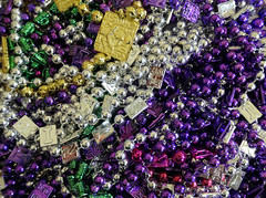 Lots of beads (Monceau) Tags: mardigras bead pile purple silver gold red necklaces macro