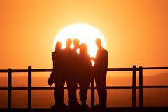 We are the aliens (Cristiano Pelagracci) Tags: sun sunset trasimeno light circle orange silhouette umbria lake black