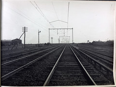 Typical 3 track construction showing overhead bridling. St. Albans line. (Public Record Office Victoria) Tags: railways train electrification blackandwhite archives victoria st albans tracks 1919