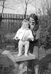 Woman and child in the garden (vintage ladies) Tags: vintage blackandwhite photograph photo woman child female garden birdbath scarf coat smile smiling