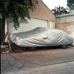 Lying in state (ADMurr) Tags: la alley covered car garage rolleiflex e 35 zeiss planar kodak ektar dad058
