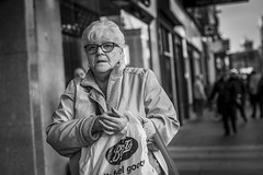 Feel Good (Leanne Boulton) Tags: urban street candid portrait portraiture streetphotography candidstreetphotography candideyecontact eyecontact candidportrait streetportrait streetlife old elderly woman female lady face eyes expression mood feeling emotion dutchangle tone texture detail depthoffield bokeh naturallight outdoor light shade city scene human life living humanity society culture lifestyle people canon canon5dmkiii 70mm ef2470mmf28liiusm black white blackwhite bw mono blackandwhite monochrome glasgow scotland uk