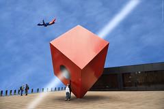 Juego imáginario con un cubo - Imaginary game with a cube (ricardocarmonafdez) Tags: cubo cube formas imagination imaginación geometría geometry cielo sky airplane people reflejos reflections light ray red blue color nikon