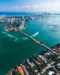 Aerial view of Miami islands on a sunny day (mano.photo24) Tags: aerial view boat sunny blue water ocean beach downtown architecture cloud sunlight florida american skyline skyscraper people highrise apartments miami city waterfront sky horizontal trees buildings causeway us travel destinations relaxation yachts port transport vacation america sunrise district panoramic sea cityscape luxury summer holidays palm helicopter drone island speedboat sailboat