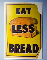Eat Less Bread (Steve Taylor (Photography)) Tags: eatlessbread rationing bread loaf ripeed torn folded poster blue black brown yellow white paper newzealand nz southisland canterbury christchurch airforcemuseum firstworldwar wigram ww1