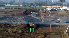 (Rich T. Par) Tags: pomona phillipsranch socal southerncalifornia losangelescounty lacounty constructionsite california palmtrees tree road suburb dirt civilengineering tubes pipes tractor frontloader heavyequipment civilengineers watertruck