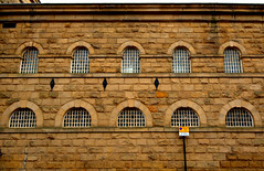 Old jailhouse in the centre of Preston (Tony Worrall) Tags: preston lancs lancashire city welovethenorth nw northwest north update place location uk england visit area attraction open stream tour country item greatbritain britain english british gb capture buy stock sell sale outside outdoors caught photo shoot shot picture captured ilobsterit instragram photosofpreston architecture building urban built jail prisons wall grill stay grim arch windows relic old closed past courts