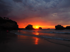 Sunset before the storm (DaveKav) Tags: biarritz 2016 august15th sunset beach sea reflection sun rocks atlantic dusk stormcoming paysbasque 64 france olympus nature sky water clouds summer ocean storm orange dark landscape seascape outside coast sunlight rayoflight aquitaine