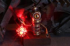 Butterfly robot fairy with red glowing lantern (Catherinette Rings Steampunk) Tags: fantasy adoptables dungeons dnd sculpture modron handmade etsy metal art artisan wirewrapped figurine creatures weird oneeyed cyclopean brass copper canadian glowing cute