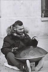János playing his hang drum (☁ ▅▒░☼‿☼░▒▅ ☁) Tags: minolta xd7 ilford xp2 400 blackwhite black white tamron sp 90mm hang drum pécs