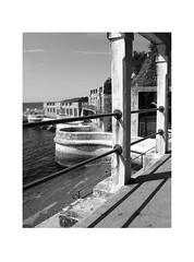sea walls (chrisinplymouth) Tags: railings fence metal seaside tinside plymouth devon england uk city monochrome black white cw69x wg diagx perspective seawall concrete xg diagonal plain