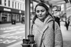 More Coffee Required (Leanne Boulton) Tags: urban street candid portrait portraiture streetphotography candidstreetphotography candidportrait streetportrait eyecontact candideyecontact streetlife woman female girl pretty face eyes expression emotion mood feeling coffee beauty beautiful coat style fashion tone texture detail depthoffield bokeh naturallight outdoor light shade city scene human life living humanity society culture lifestyle people canon canon5dmkiii 70mm ef2470mmf28liiusm black white blackwhite bw mono blackandwhite monochrome glasgow scotland uk