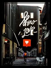 Show Love (Steve Taylor (Photography)) Tags: showlove heart backpack graffiti mural architecture streetart cafe tableandchairs black brown contrast mauve orange white newzealand nz southisland canterbury christchurch cbd city perspective reflection