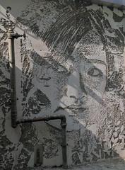 Face on the Wall (cowyeow) Tags: china street chinese asia asian 香港 hongkong sheungwan city urban composition graffiti wall streetart weird face big chipped sculpted art concrete texture lighting pipes portrait man