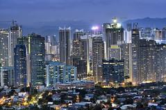 Development (Sumarie Slabber) Tags: city night buildings mountains light tripod nikon sumarieslabber longexposure construction manila philippines