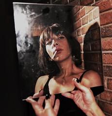 Sinner (Johnidis) Tags: portrait woman smoke smoking cigarette smoker bricks wall mirror night urban light shadow hands