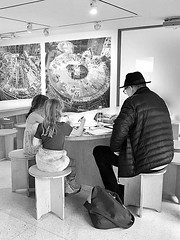 Young Artists (Demmer S) Tags: museum art artists drawing creating tables chairs round drawings three people sitting room peoplewatching documentary person urban city indoors urbanphotography inside interior girls kid kids child children girl young artist hat ceiling lights museums solomonrguggenheimmuseum guggenheim artmuseum gallery artwork paintings architecture architectural modern contemporary guggenheimmuseum theguggenheim franklloydwright historic landmark fifthavenue 5thavenue uppereastside ny newyork nyc newyorkcity manhattan eastcoast bw monochrome blackwhite blackandwhite blackwhitephotos blackwhitephoto hats