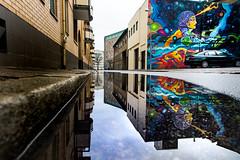 Mural in puddle reflection (explore 2019-01-09) (Maria Eklind) Tags: urban mural change urbanart perspective malmö lillakvarngatan gatukonst dansapunar spegling sweden graffiti streetart reflection spaceism art skånelän sverige se