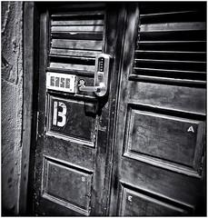Lomography (Black and White Fine Art) Tags: lomography lomografia lomo holga120s plasticcamera camaraplastica toycamera camaradejuguete kodakbw400cnexp2007 filmexpired peliculaexpirada 2007 niksilverefexpro2 lightroom3 puerta door sanjuan viejosanjuan oldsanjuan puertorico