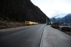 White Pass Gondola Cars (i threw a guitar at him.) Tags: white pass alaska yukon railroad rail road gondola car cars yellow train tracks mountain landscape dock evening pavement sidewalk side industry mining transport shipping development local economy port south east free creative commons