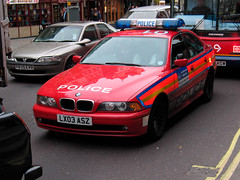 """Cop Car 031204 (hoffman) Tags: england english uk britishisles greatbritain ec eec europe london police car vehicle traffic street outdoors red davidhoffman wwwhoffmanphotoscom davidhoffmanphotolibrary socialissues reportage stockphotos""""stock photostock photography"""" stockphotographs""""documentarywwwhoffmanphotoscom copyright"""