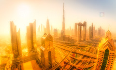 City of Gold (Scott Masterton) Tags: arab burj burjkhalifa dubai east emirates khalifa middle newkeywords united unitedarabemirates view arabia arabian arabic architecture birdseyeview building business city cityscape color concrete construction daytime downtown dubaiskyline futuristic glass gold gulf highway landmark landscape luxury metropolis metropolitanarea modern outdoors road scene sky skyline skylinecity skyscraper skyscrapers sunrise tallest tallestbuildingworld tourism tower towerblock traffic transportationsystem travel uae urban urbanarea geocountry geocity exif:model=pentaxk70 exif:lens=sigmaortamronlens geostate geolocation geo:lat=25218516487652 exif:isospeed=100 geo:lon=55272156091017 exif:make=ricoh exif:focallength=10mm exif:aperture=ƒ90 camera:model=pentaxk70 camera:make=ricoh