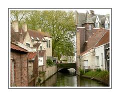 Bruges (Audrey A Jackson) Tags: panasonicdmctz3 bruges belgium canal buildings trees