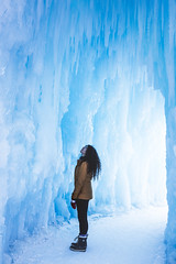 Lady looks up (Bluesky251) Tags: alberta art beautiful blue bright canada cave cold color colorful daylight daytime edmonton freeze frozen glow ice icecastle icicle lifestyle light model outdoor outside person photography snow weather white winter