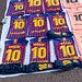 Street vendor sells Lionel Messi FC Barcelona soccer jerseys and Kylian Mbappé Merchandise at a flea market in Spain