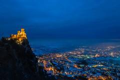 Blue hour in San Marino (lucafabbricesena) Tags: bluehour republicofsanmarino snow rocca guaita fortress tower monte titano mountain italianlandscape winter lights history twilight dusk stone evening outside nikkor blue night