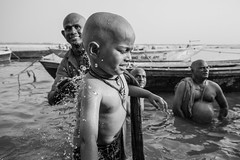youngest pilgrim (s.v.e.n.) Tags: dashashwamehd ghat varanasi india benares hindu pilgrim ganga ganges river bath dip father son travel street religion water canon 5dmkii 1635mm 35mm