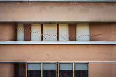 ban (Laura Sergiampietri) Tags: architecture urban ban tape cautiontape warningtape warning geometric geometry windows blinds façade lines stripes colours smcpa3570f3545 smcpentaxa3570f3545 shutters shades balcony terrace white red flat peoplessness empty emptiness