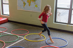 57/365 Jump Rings (Maggggie) Tags: 365 child girl jumping hulahoops rings play blurry 365the2019edition 3652019 day57365 26feb19