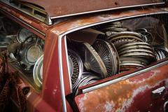 parts car (jtr27) Tags: dsc07835l jtr27 sony alpha nex7 nex minolta 50mm f14 lensturbo manual focus maine hubcaps junkyard