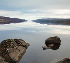Rannoch mirror (Marion McM) Tags: water loch lochrannoch rocks reflection stillness mirror calm mountains clouds sky landscape canoneos760d 2019