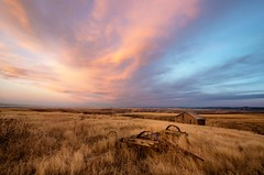 Sublimis (garshna) Tags: sunset building clouds abandoned wagon field grasses sky outdoor landscape