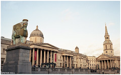 The Invisible Enemy Should Not Exist (peterphotographic) Tags: img026edwm theinvisibleenemyshouldnotexist leica m6 leicam6 summarit 35mm summaritm35mmf25 ©peterhall trafalgarsquare nationalgallery london england uk britain city cityscape urban architecture building gallery church spire classical column tourist michaelrakowitz film scanned analog filmsnotdead kodak kodakportra400 portra